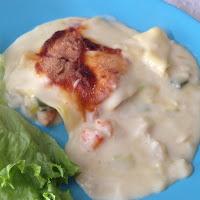Lasanha de pescada e camarão com alho francês