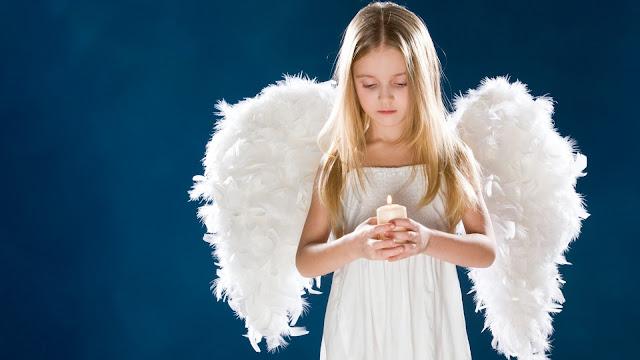 Hermosa Niña con alas de angel