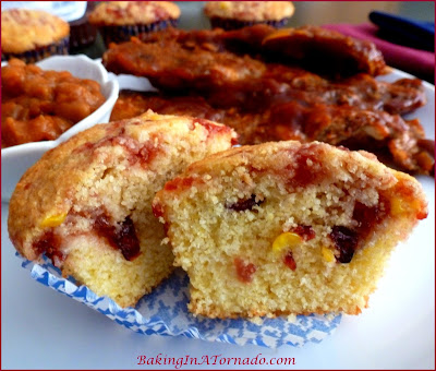 Cranberry Swirl Corn Muffins, a classic corn muffin with a swirl of cranberry sauce and cranraisins for added flavor | Recipe developed by www.BakingInATornado.com | #recipe #muffins