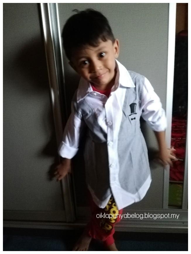 Abang Ammar dapat baju cantik habuan menang giveaway anjuran blog CeritaMak.
