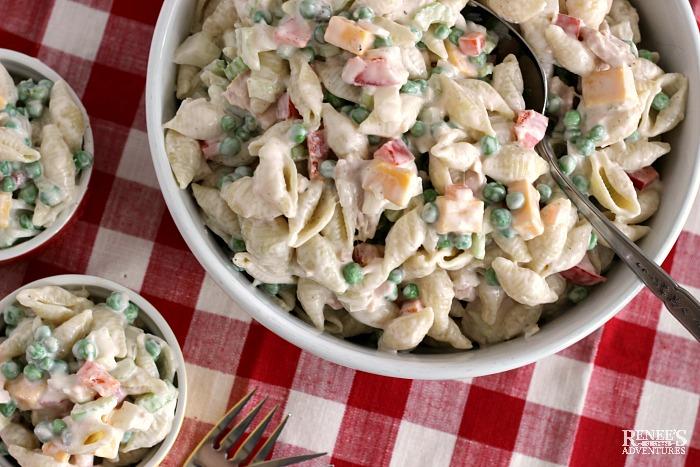 Creamy Tuna Pasta salad in serving bowls and individual bowls