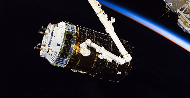 The H-II Transfer Vehicle-7 (HTV-7) from JAXA (Japan Aerospace Exploration Agency) is pictured after it was captured by the Canadarm2 operated by Expedition 56 Commander Drew Feustel as Flight Engineer Serena Auñón-Chancellor backed him up inside the cupola. The HTV-7 took a four and a half day trip to the space station after launching Sept. 22, 2018, from the Tanegashima Space Center in Japan. Credit: NASA
