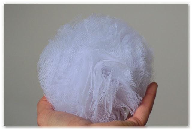 pompon en tulle blanc à paillettes holographiques