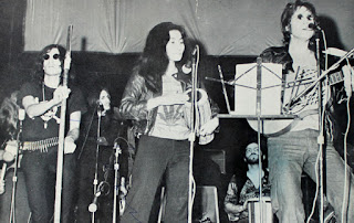 David Peel (left) with John Lennon and Yoko Ono at the John Sinclair Freedom Rally in 1971.