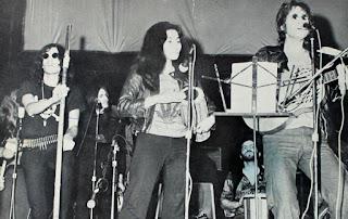 David Peel (left) with John Lennon and Yoko Ono at the John Sinclair Freedom Rally in 1971.