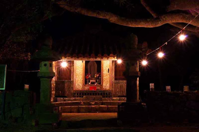 shrine illuminated at night