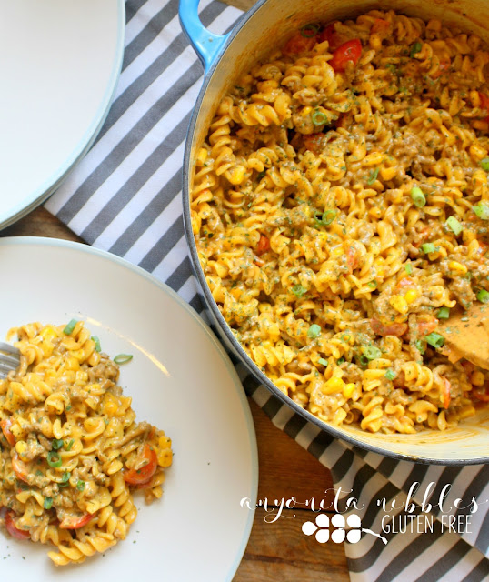 This creamy, gluten free taco pasta is cooked in one pot and comes together in under 20 minutes, giving you your evenings back!