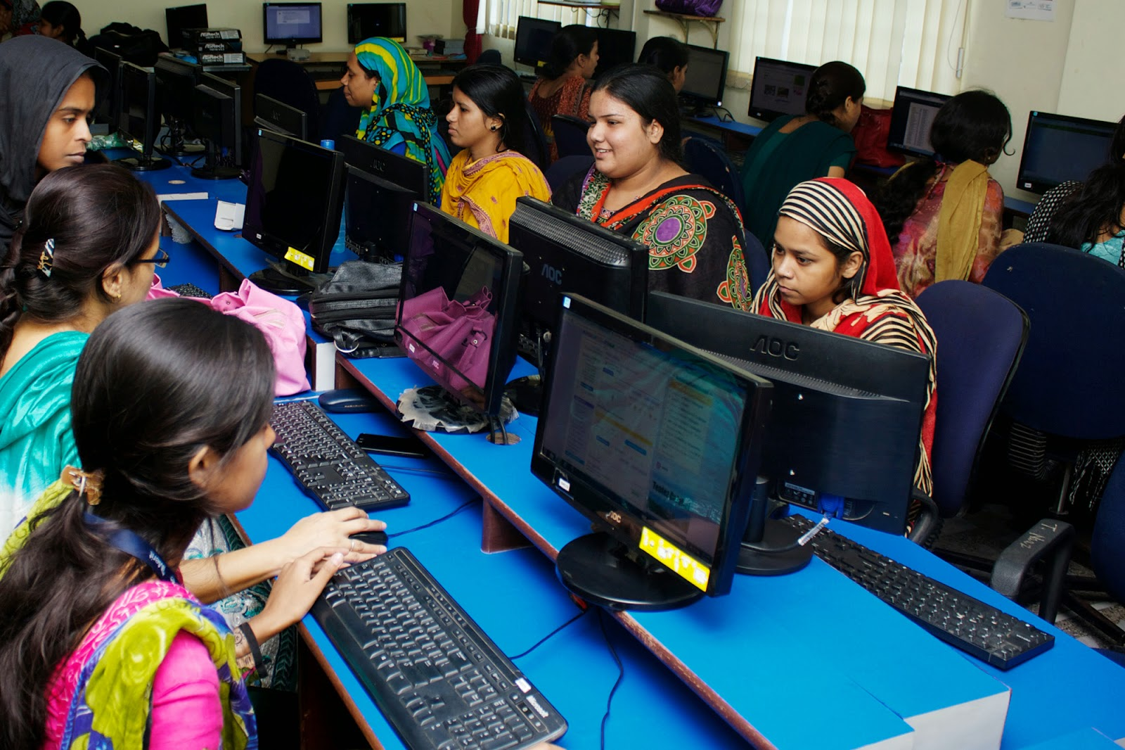 Employees in iMerit's Metiabruz center complete a web-based project. Photo credit: Emanuel Ott.