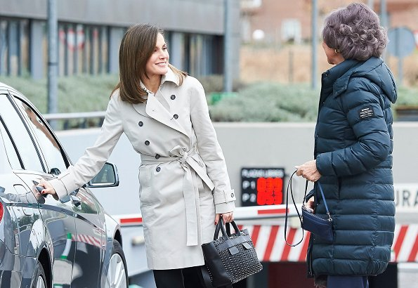 Queen Letizia wore HUGO BOSS Heylen Trousers and Hugo Boss trench coat. Letizia carried Hugo Boss Shoulder bags, Hugo shoes