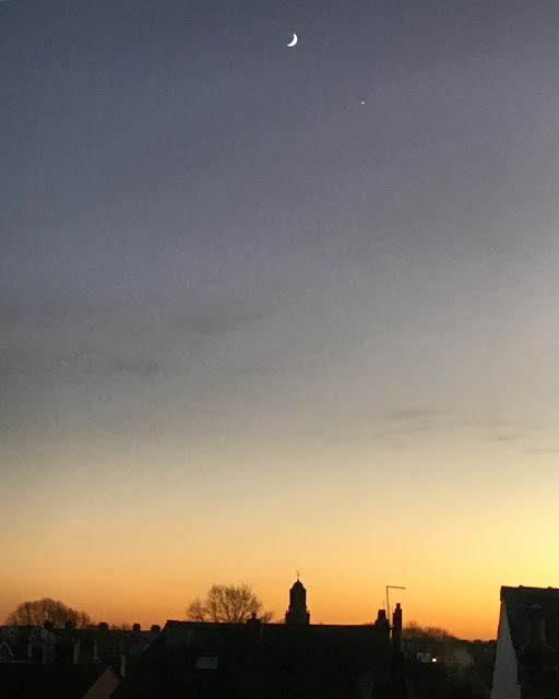 sunset with crescent moon and venus