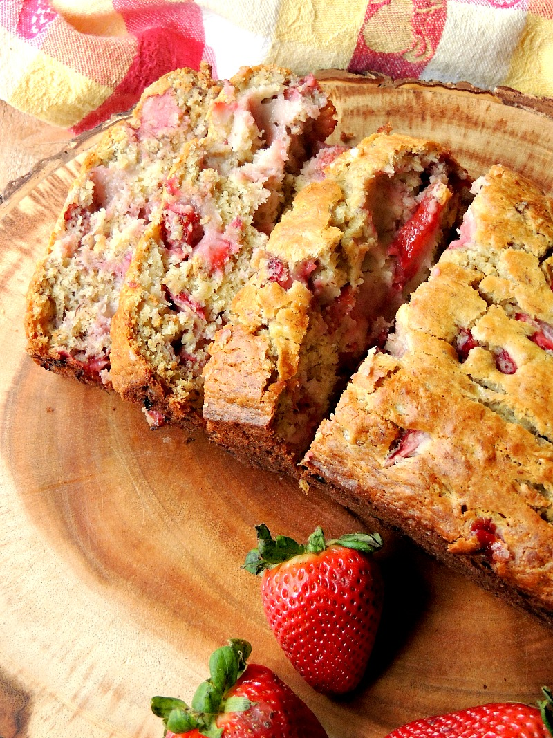 Strawberry Banana Bread - This bread recipe combines to of my favorite flavors in an amazingly moist and tender loaf. If you love strawberries and bananas, this bread is a MUST make!! #banana #strawberry #bread #quickbread #recipe | bobbiskozykitchen.com