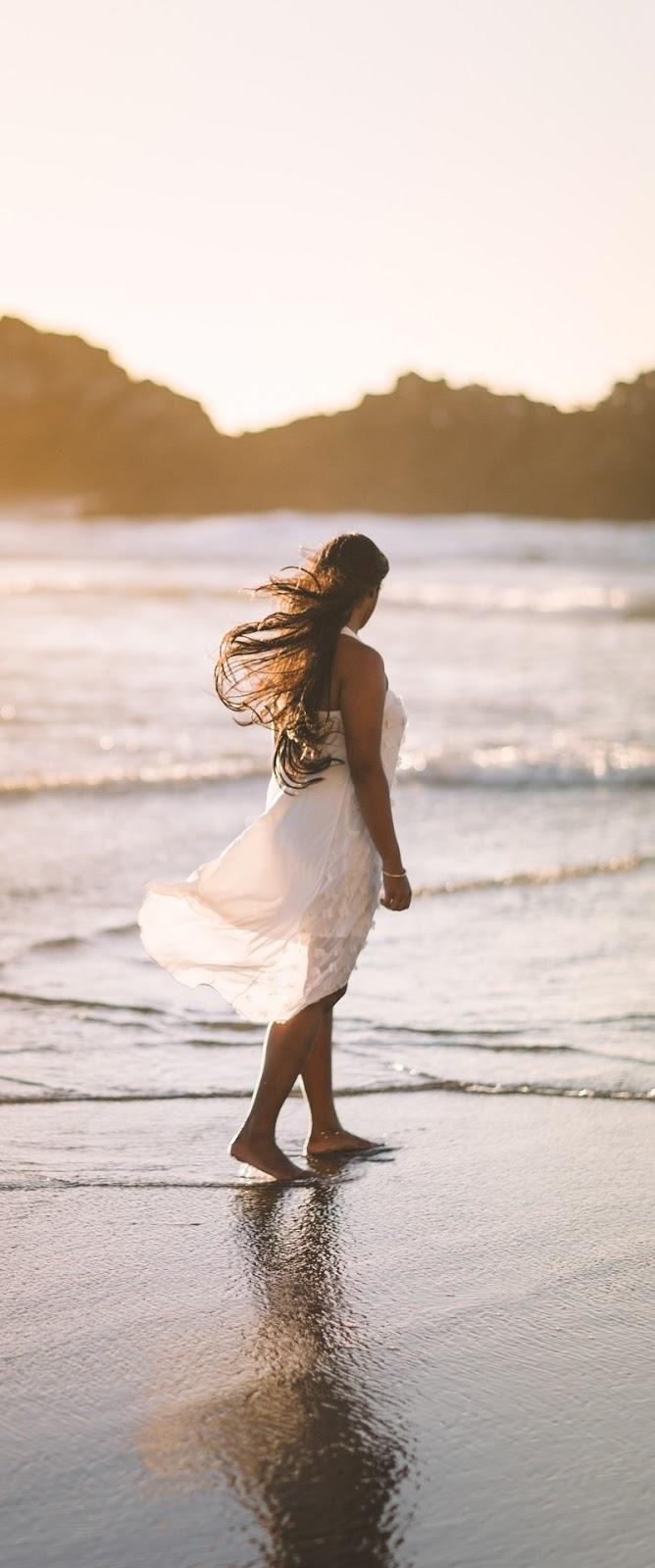 Woman at a beach.