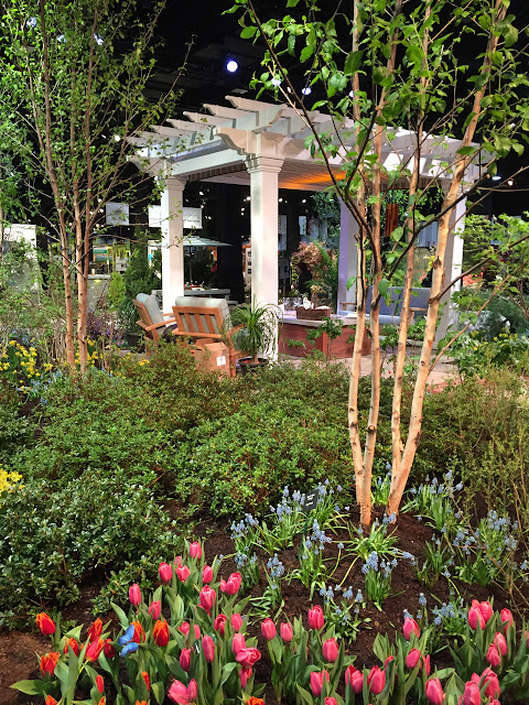 This here is my dream backyard | Pergola with comfy seating and gardens galore! | Boston Flower & Gift Show 2017