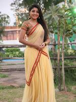 Aditi Menon dazzling in half saree-cover-photo