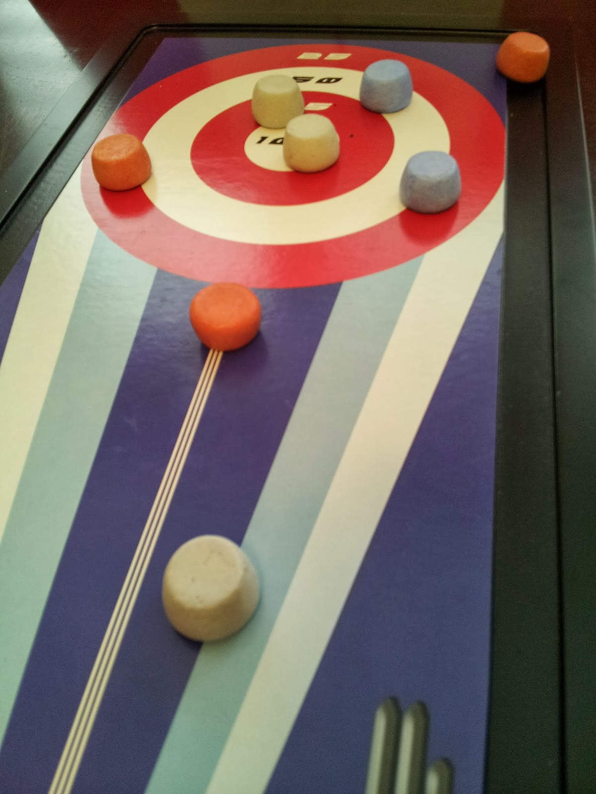 tabletop shuffleboard, winter activities, Olympics at home, kids, sports