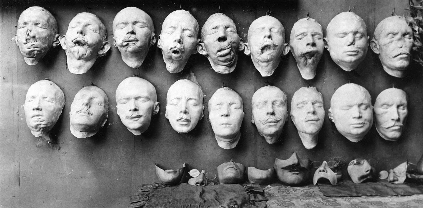 The top row of casts shows the first step in the process as these were molded from the soldiers' disfigured faces.The bottom row of casts shows the molds with restorative work sculpted by Anna Coleman Ladd.