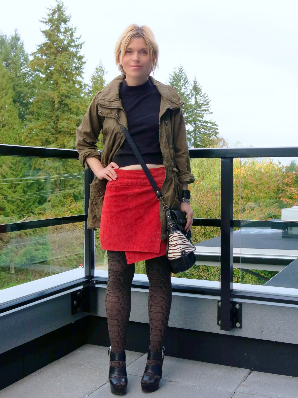 Vegging out:  a red suede mini-skirt with patterned tights and an army-style parka