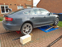 Audi S5 Sportback jacked up on ramps