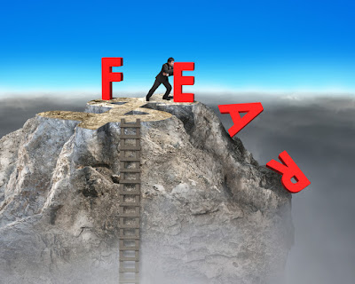 One by one, the letters F, E, A, R are pushied off a cliff