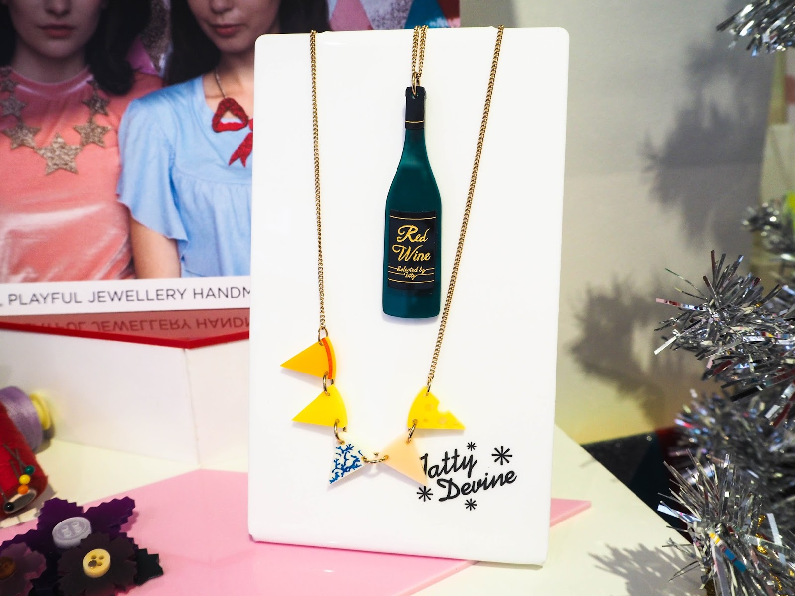 Tatty Devine red wine necklace and cheese necklace