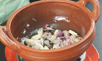 adding-shallots-for-making-karuvaatu-kuzhambu