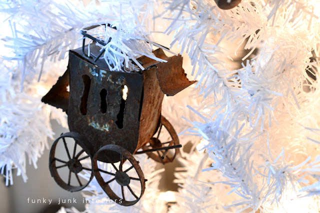 rusty ornament via Funky Junk Interiors