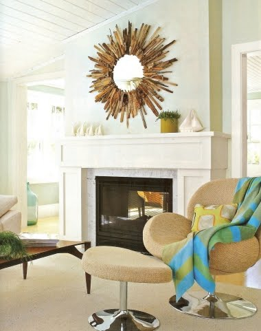 large sunburst mirror over fireplace