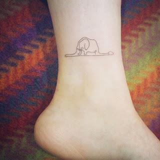 tatuaje sombrero o elefante