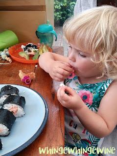 Big toddler eating sushi