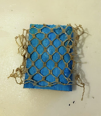 Match box with net on top