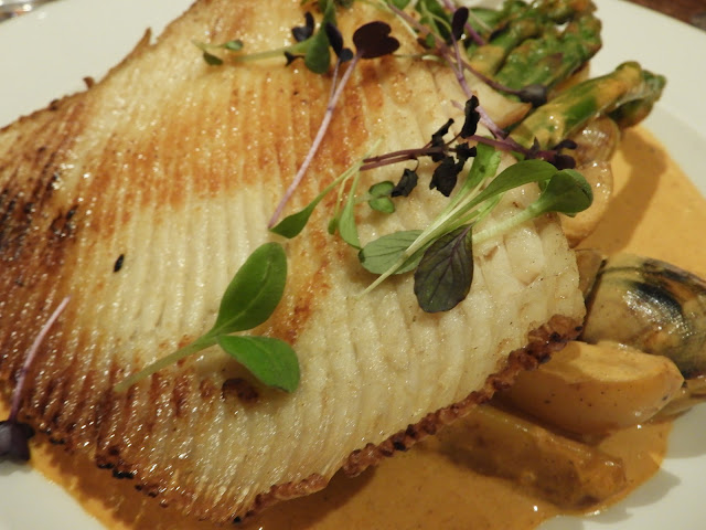 Skate Pan roasted local skate with a fresh crab bisque, brown shrimp,  local seven score asparagus, spinach & new potatoes