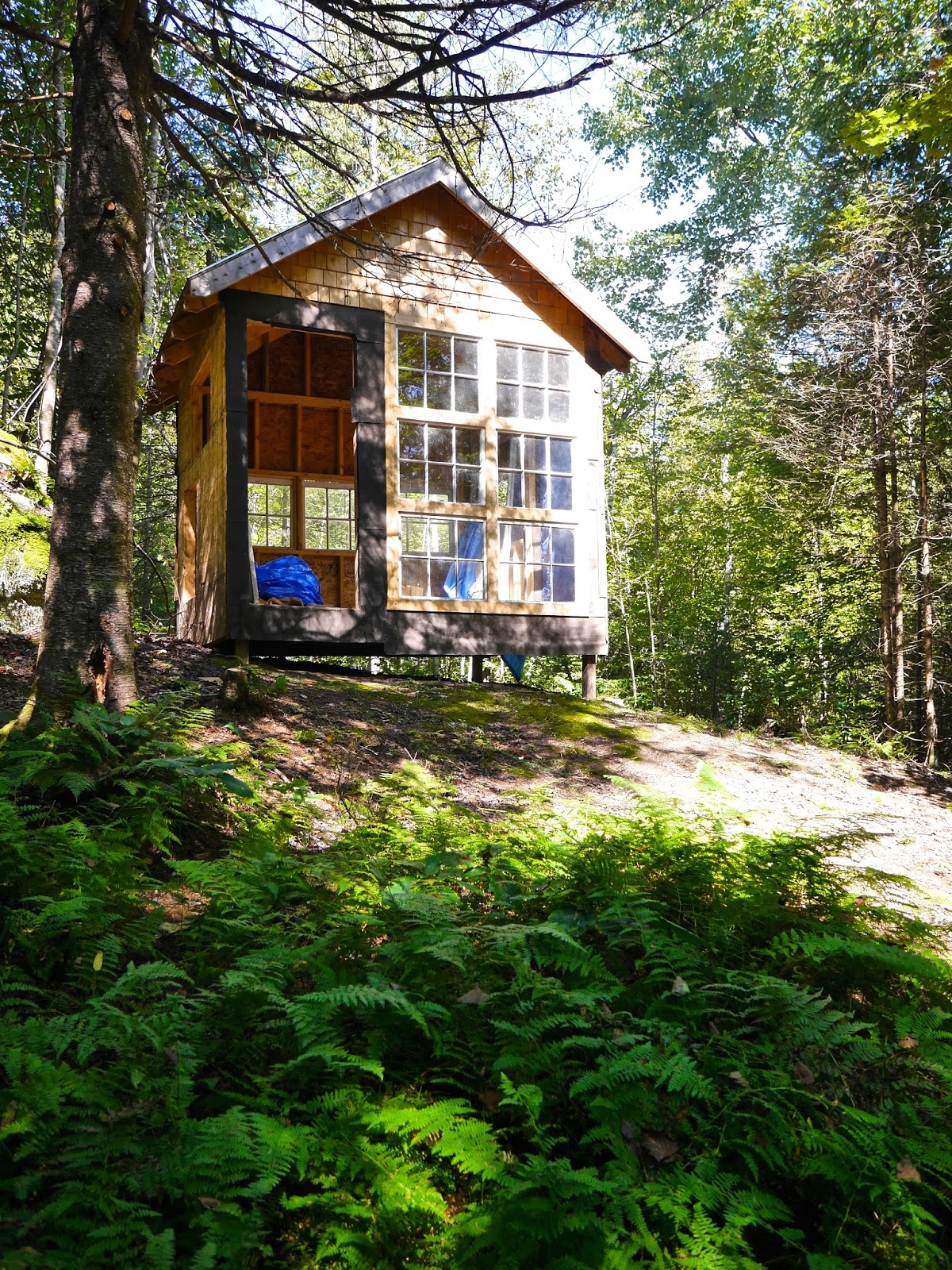 Building a shed on a hill - One Cabin 8 By 14 That We Ll Work On It Still Needs A Loft Insulation Bathroom Deck Trim Door And More This Is One Of A Few Projects On Our