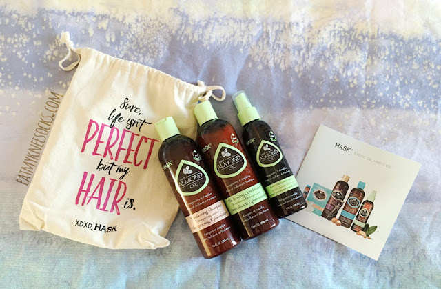Details on HASK's mint almond oil hair care collection, featuring their thickening shampoo and conditioner, root thickening spray, and adorable drawstring canvas bag for the ultimate salon-quality hair treatment.