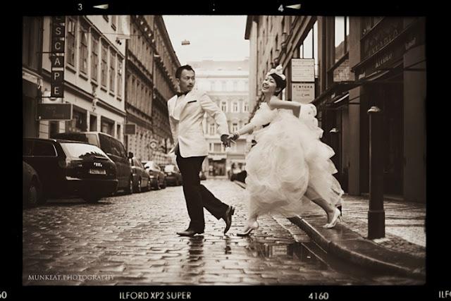groom pulling bride crossing the road