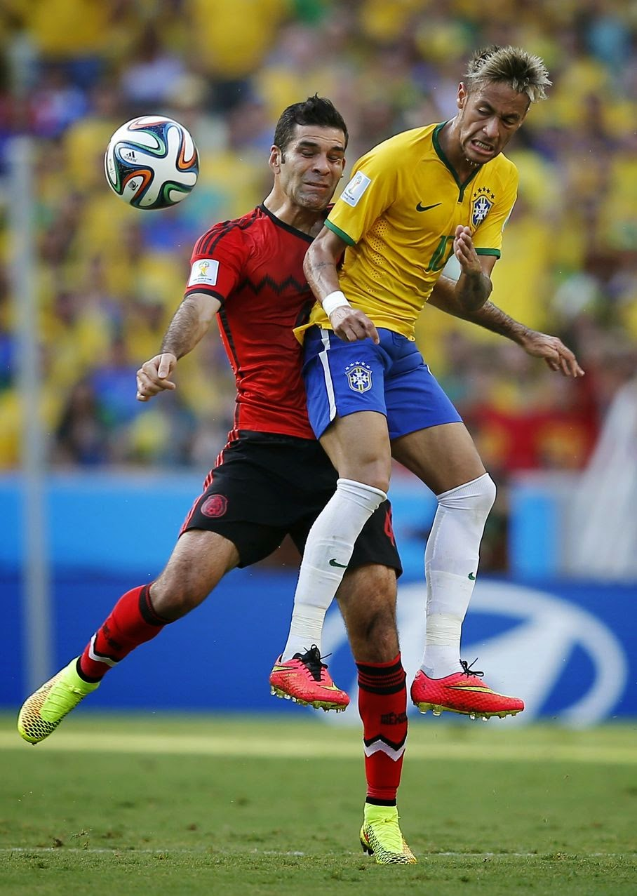 Mexico's Rafael Marquez, left, collides with Brazil's Neymar during the group A World Cup soccer match between Brazil and Mexico at the Arena Castelao in Fortaleza, Brazil, Tuesday, June 17, 2014.