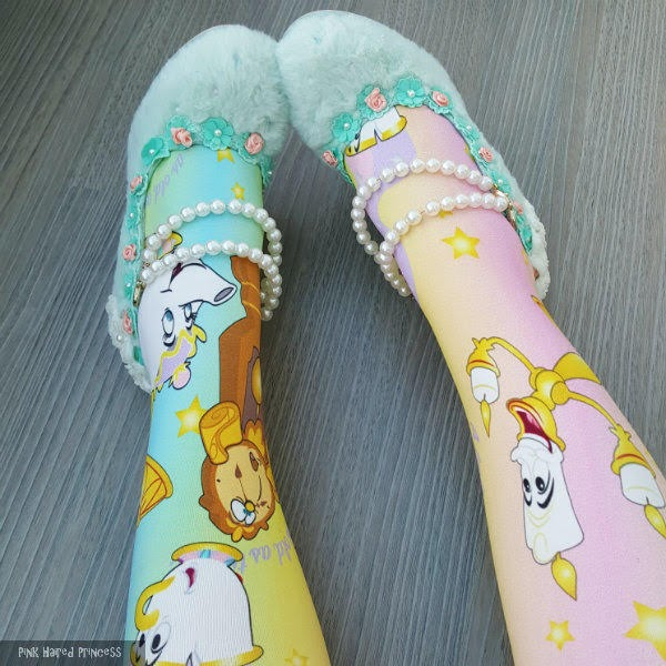 close up of disney pastel beauty and the beast tights and fluffy pearl shoes