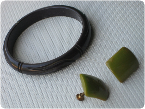 carved bakelite bracelet and green bakelite screw back earrings