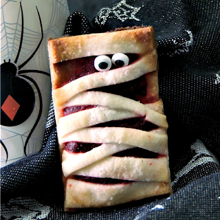These little Cheesecake Mummies Cookies try to be scary, but they are just too cute #cookies #Halloween #Mummies #mummy #cheesecake #recipe | bobbiskozykitchen.com