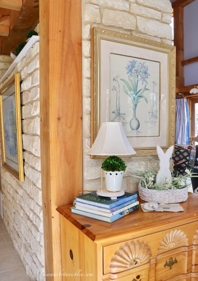 Usher in spring with white bunny arrangement at end of stone fireplace