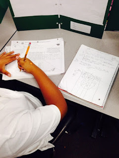 One student uses math notes to assist him or her in solving the problem.