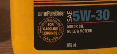 Showing label on 1L 5W30 oil jug