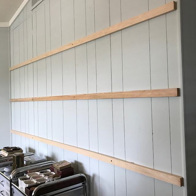Blank wall with three slats of wood