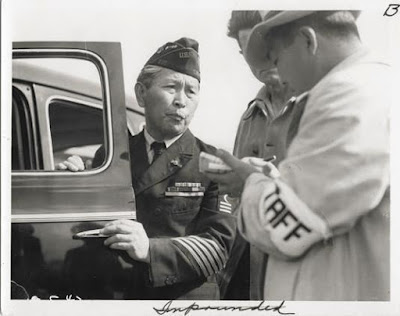 Clem Albers, Dressed in uniform marking service in the First World War,  this veteran enters Santa Anita assembly center for persons of Japanese ancestry  evacuated from the West Coast, 1942 Courtesy National Archives and Records Administration