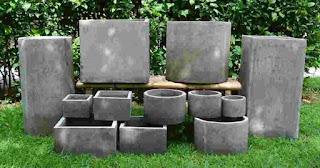 Maceteros de piedra u hormigón para interiores