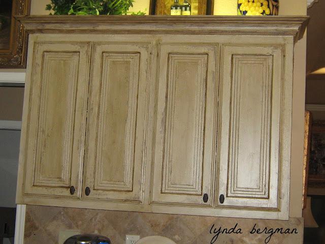 Lynda bergman decorative artisan faux antique copper for Antique white finish kitchen cabinets
