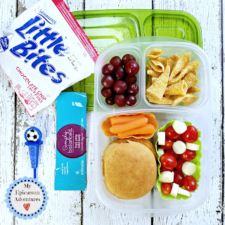Lunch box fun with a chicken patty sandwich and a healthy tomato mozzarella salad. In our @easylunchboxes #lunchboxideas