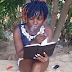 Unbelievable!! See Photo Of Naija Girl Smoking and Reading The BIBLE At The Same Time