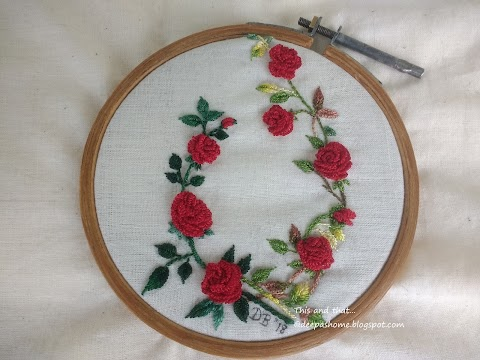 Completed embroidery and crochet pieces