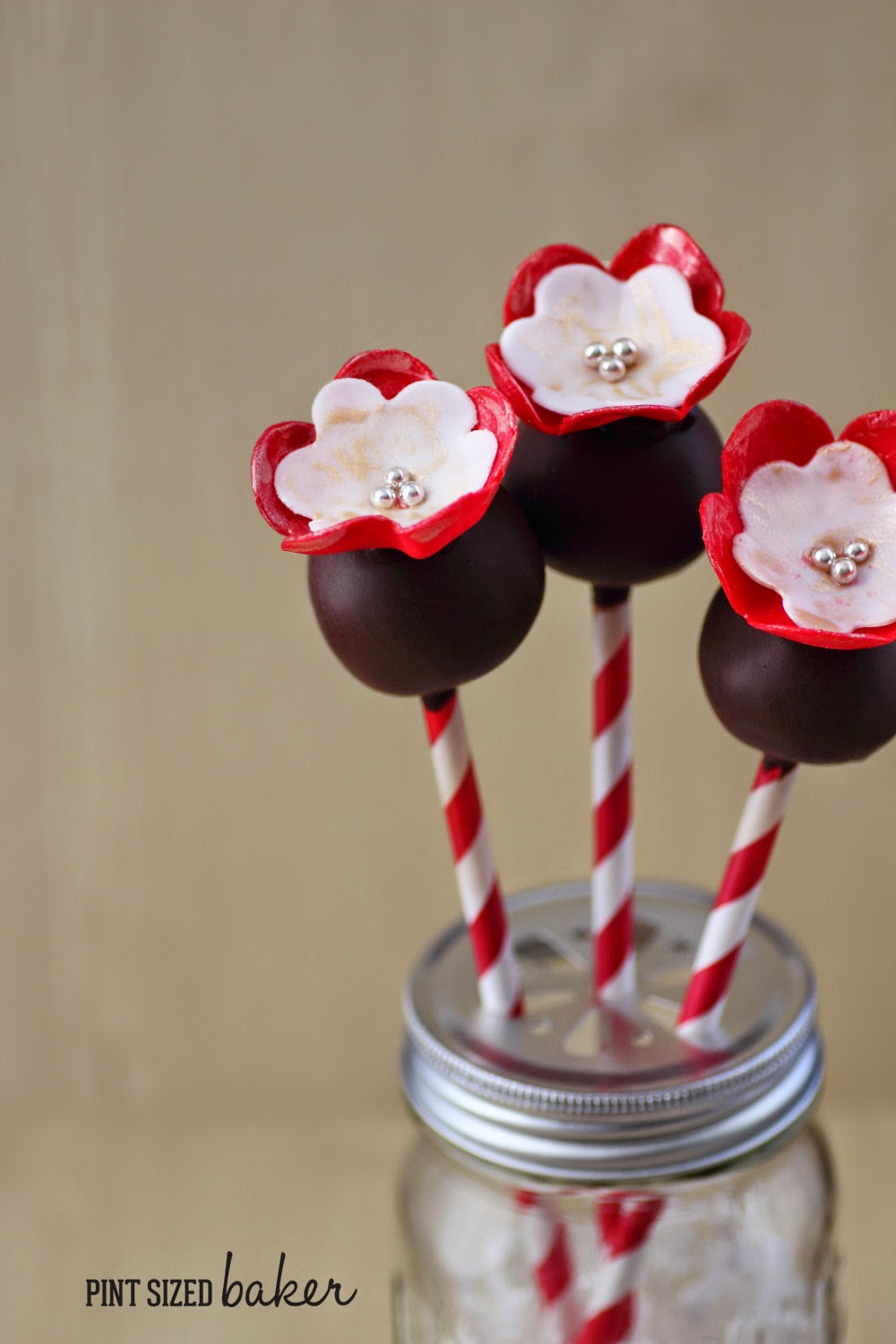 I'm loving these easy cake pops with pretty fondant flowers! My daughter would love them!