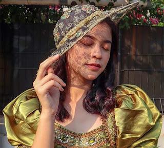 Arifah Lubai Pakai Topi